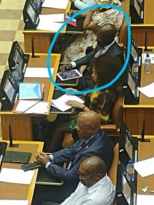 "Minister of Finance plays ""Candy Crush"" on his tablet in Parliament"