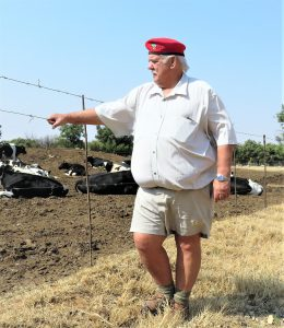 White farmer from Bultfontein wears his red EFF beret proudly because only EFF wants to help him