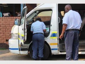 Doing it the African way: The main building of the KwaThema Police Station has been shut down, officers have resorted to working from state vehicles