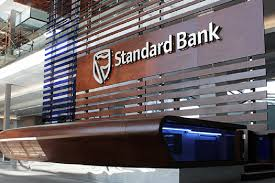Standard Bank warned that their license will be suspended if they close Gupta's bank account
