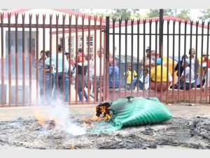 Police and and Gauteng Department of Education officials held hostage by the community in protest for new school